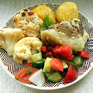 Свиная рулька запеченная в духовке с овощами